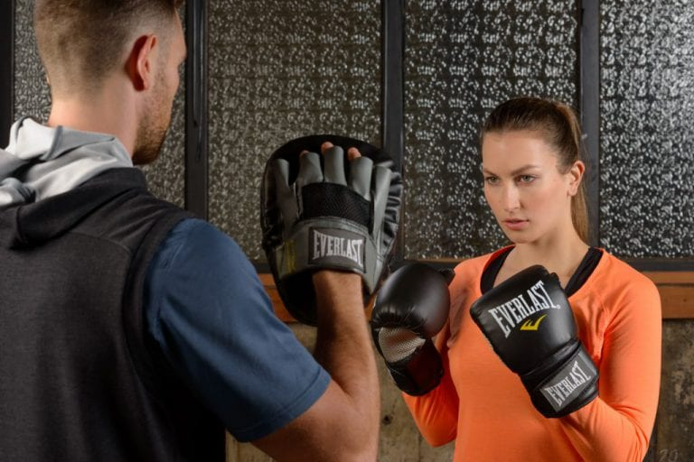 Commercial photography with female and male fitness models boxing