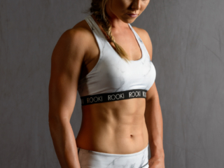 Advertising photo of female fitness model in activewear