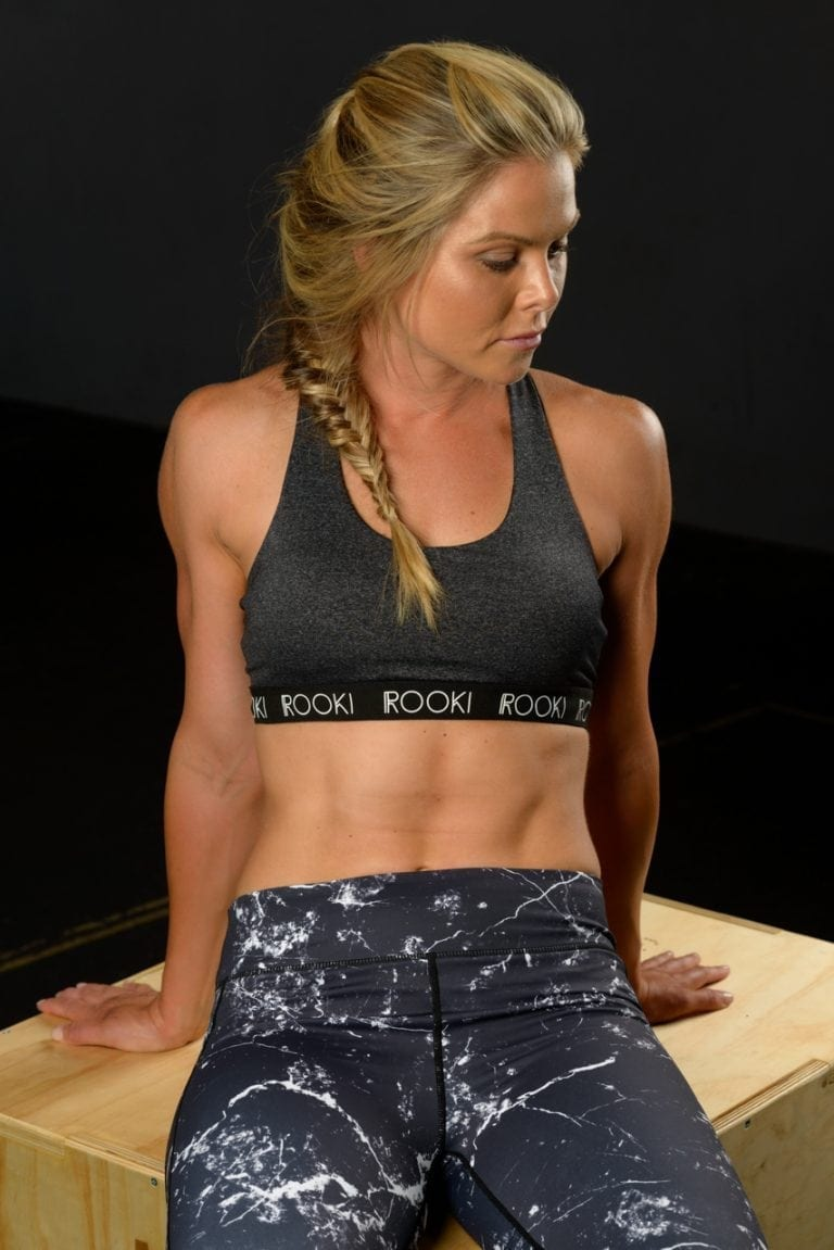 Advertising photo of female fitness model wearing activewear