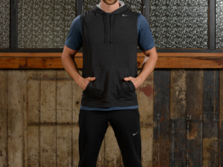 Commercial lookbook photo of male fitness model wearing sports clothing