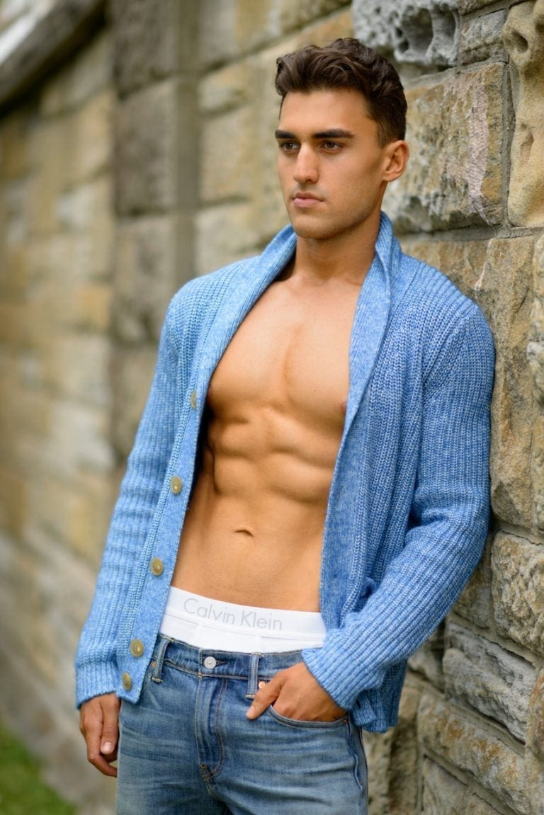 Commercial photo of male fitness model wearing open cardigan