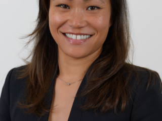 Corporate headshot of a smiling female against a plain background