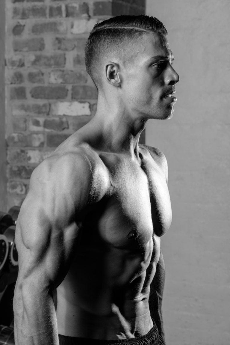 Muscular male fitness model in gym