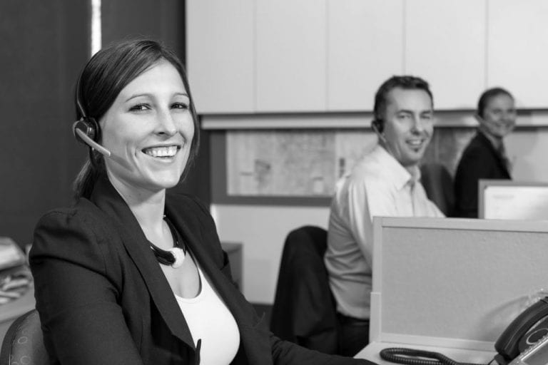 Smiling customer service personnel at work