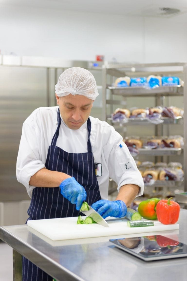 Chef chopping vegetables in a commercial kitchen