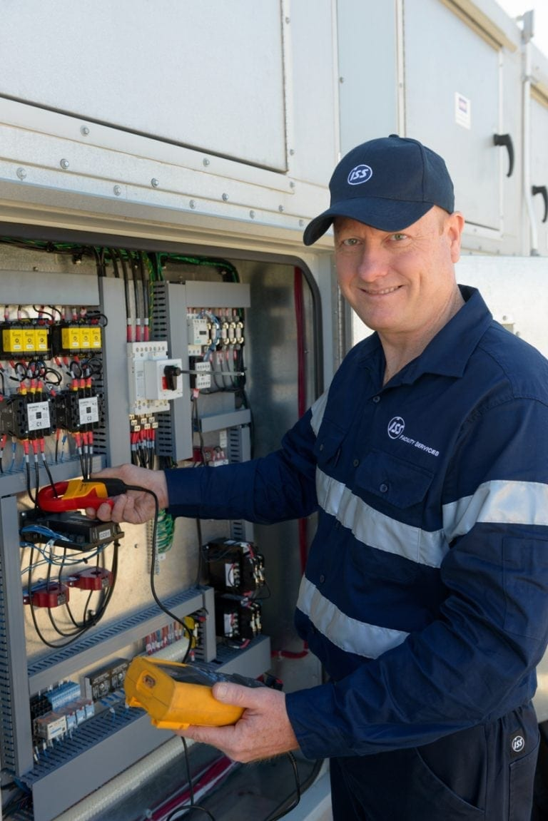 Smiling electrician pauses for a photograph